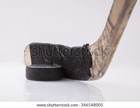 Hockey puck and stick - stock photo