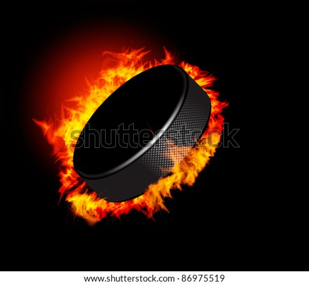 Hockey Puck in Fire isolated on Black Background - stock photo