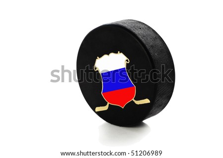 hockey puck isolated on white background - stock photo