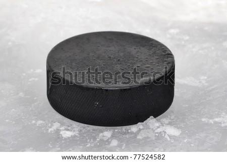 hockey puck on ice - stock photo
