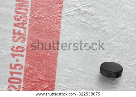 Hockey puck on the ice arena. Concept - stock photo