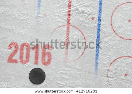 Hockey season 2016 and the puck on the ice. Concept