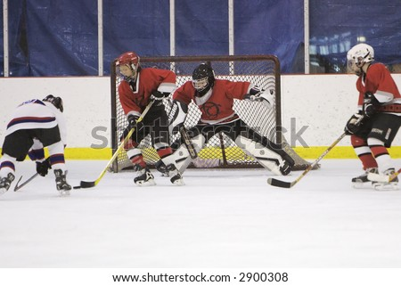 Hockey shot on goal - stock photo