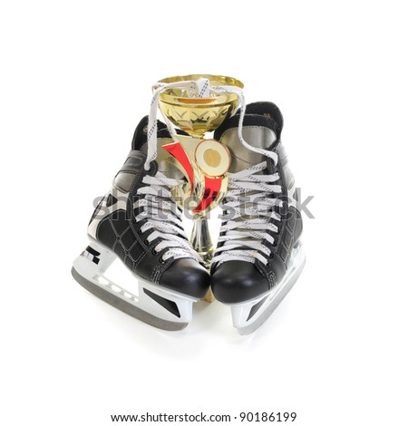 Hockey skates and cup winner. Isolated on white background - stock photo