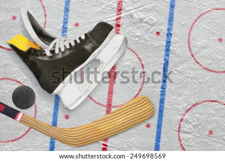 Hockey skates, stick and puck on a hockey rink. Concept - stock photo