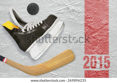 Hockey skates, stick and puck on the ice.  - stock photo