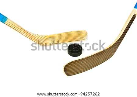 Hockey stick and puck. Isolated on white background - stock photo