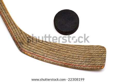 Hockey stick and puck on white background - stock photo