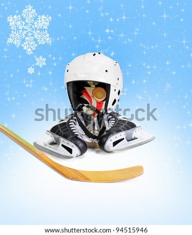 Hockey stick ice skating helmet cup winner. on blue background - stock photo