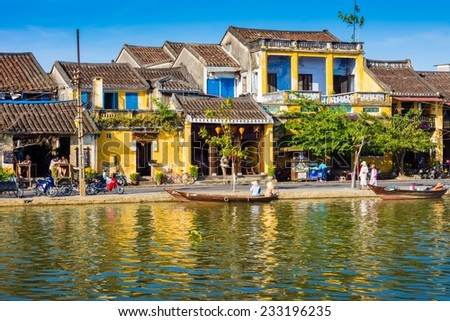 Hoi An, Quang Nam, Vietnam, February 2014: The traditional boat moored on the river in the ancient town of Hoi An, Vietnam. - stock photo