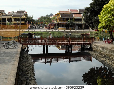 HOI AN, VIET NAM- FEB 17, 2016: Group of people travel Hoian old town, ancient house, country heritage, city friendly with environment, walk, bicycle or pedicab on street, traveller visit at Vietnam