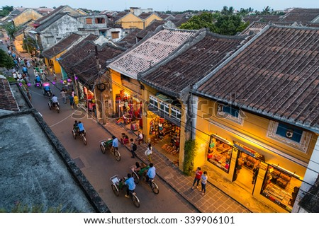 HOI AN, VIETNAM - CIRCA AUGUST 2015: People walking on the streets of old town Hoi An, Vietnam