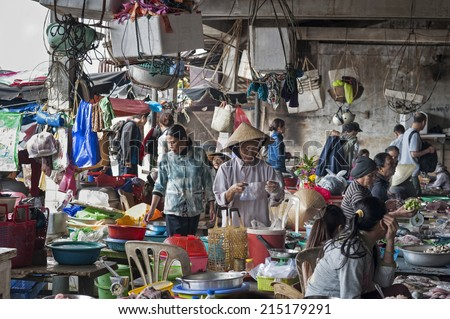 HOI AN - VIETNAM - JANUARY 6, 2014 Scenery of several market-woman at a fishmarket in Hoi An, Vietnam. Many different kinds of fish and seafood are offered. - stock photo