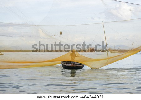 HOI AN, VIETNAM - JULY 17, 2015: An unidentified fisherman worked in fishing village of Cua Dai, Hoi An, Vietnam on January 23, 2015. Hoian is recognized as a World Heritage Site by UNESCO.