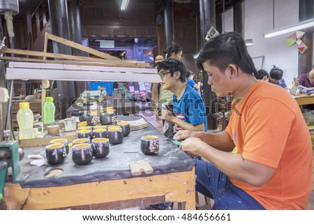 HOI AN, VIETNAM - JULY 17, 2015:At factory of persons with disabilities. Handmade Colorful souvenir at Hoi An old town, Vietnam