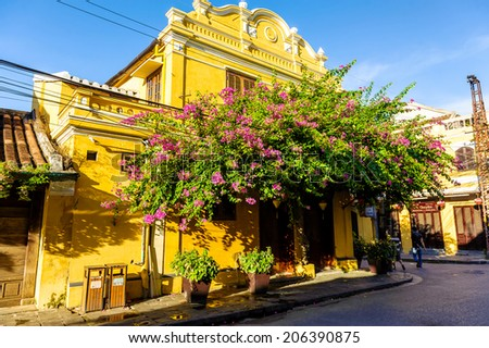 HOI AN, VIETNAM - JULY 13, 2014:  Old house on the street in Hoi An. Hoian is recognized as a World Heritage Site by UNESCO. - stock photo