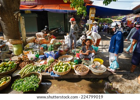 HOI AN, VIETNAM - MAY 12, 2014. Fruits and vegetables vendors selling products at Hoi An market in Hoi An Ancient Town, Quang Nam, Vietnam. Hoi An is recognized as a World Heritage Site by UNESCO. - stock photo