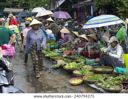 HOI AN, VIETNAM - October 17th, 2014. Fruits and vegetables vendors selling products at Hoi An market in Hoi An Ancient Town, Quang Nam, Vietnam.  - stock photo