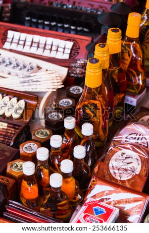 HOI AN, VIETNAM - SEPTEMBER 10: A bottle of alcohol containing a Cobra snake and scorpions in Hoi An, Vietnam on SEPTEMBER 10, 2014. Localy known as Happy Water and supposed to boost male virility. - stock photo