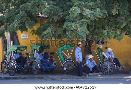 HOI AN, VIETNAM - SEPTEMBER 5, 2015: unidentified cyclo drivers of Hoi An are taking a rest and are waiting for the next trip in Hoi An,Vietnam  - stock photo