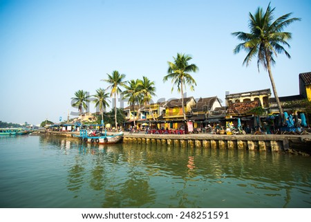 HOIAN, VIETNAM, JANUARY 26: Hoai river in ancient Hoian town on January 26, 2015 in Hoian, Vietnam. Hoian is recognized as a World Heritage Site by UNESCO. - stock photo