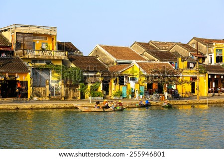 HOIAN, VIETNAM, JANUARY 23: Hoai river in ancient Hoian town on January 23, 2015 in Hoian, Vietnam. Hoian is recognized as a World Heritage Site by UNESCO. - stock photo