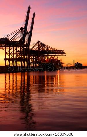 hoisting cranes, container cargo terminals. Harbor of Hamburg. - stock photo