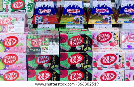 HOKKAIDO, JAPAN - OCTOBER 16, 2013: Japanese Sweets Snack in new chitose airport duty free shop green tea matcha, sakura-matcha, and strawberry cheesecake Kit Kat, Nestle Crunch Mount Fuji Edition