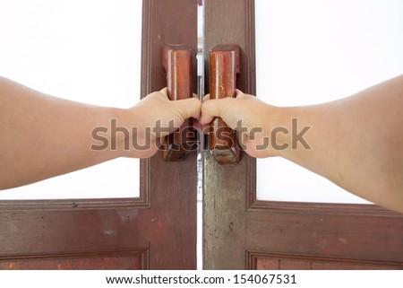 hold handle of wood door - stock photo