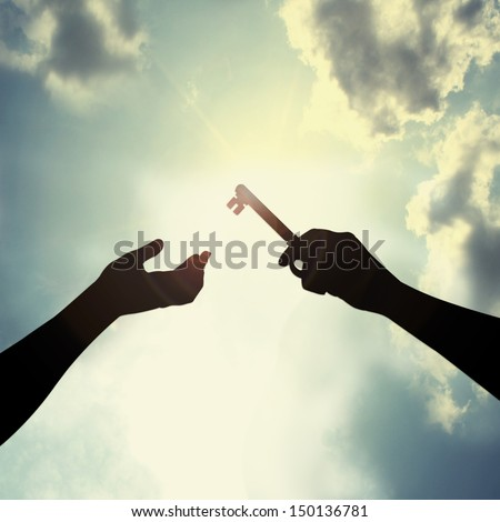 Hold key in sky - stock photo