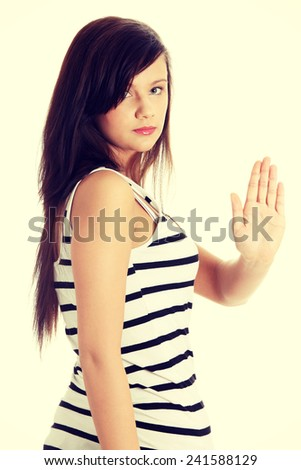 Hold on, Stop gesture showed by young teen woman hand.