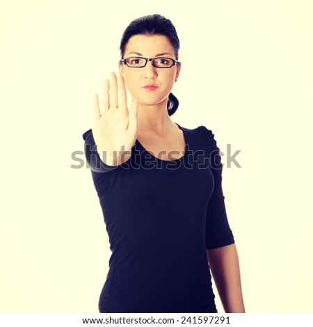Hold on, Stop gesture showed by young woman hand. - stock photo