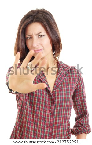 "Hold on, Stop gesture with indignation showed by young pretty woman,  woman says no to the camera/viewer by showing the palm of the hand and looking away, ""talk to the hand"" - stock photo"