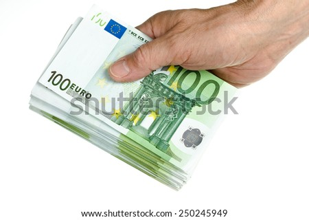 Hold stack of 100 euro in hand on white - stock photo