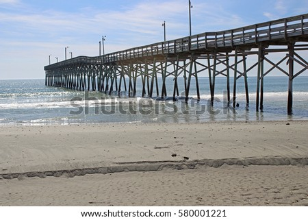 Nc beach stock images royalty free images vectors for Holden beach fishing pier