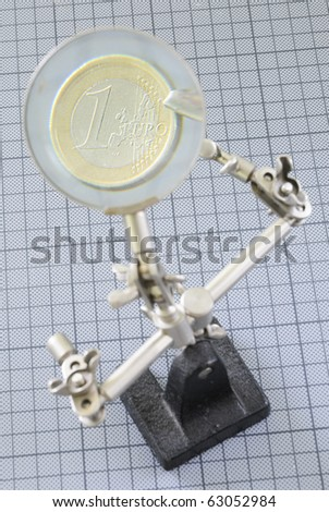holder with magnifier and money - stock photo