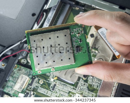 holding a circuit board and installing or repairing computer components,fixing computer,fix computer - stock photo