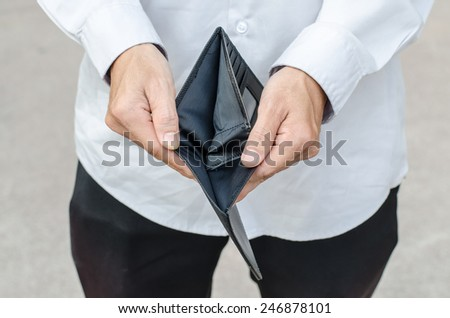 Holding a closeup to an empty wallet - stock photo