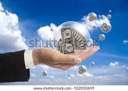 Holding a dollars in the balls. - stock photo