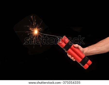 Holding a dynamite stick on. - stock photo