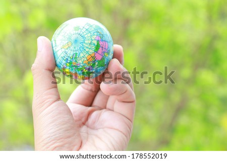 holding a globe in his hands.  - stock photo