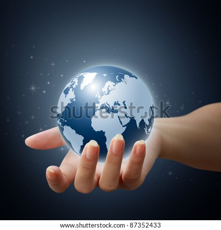 holding a glowing earth globe in his hand on star and blue background