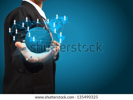 Holding a glowing earth globe social network in the hands of businessmen - stock photo
