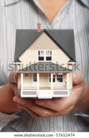 Holding a home for sale - stock photo