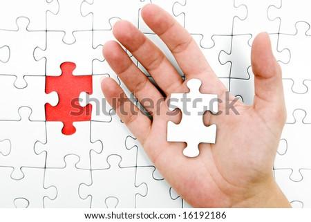 Holding a Jigsaw Piece - stock photo