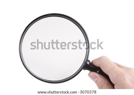 Holding a magnifying glass on a white background