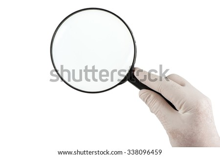 Holding a magnifying glass on white background  - stock photo