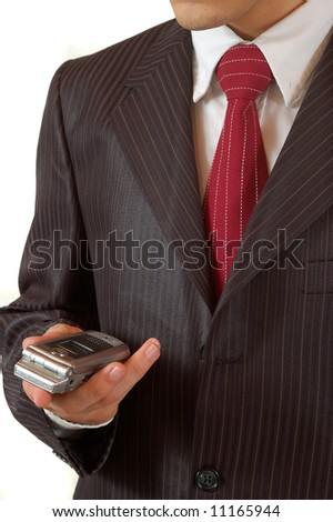 holding a mobile phone - stock photo