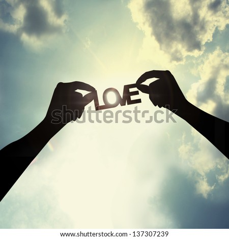 holding a paper cut of love - stock photo