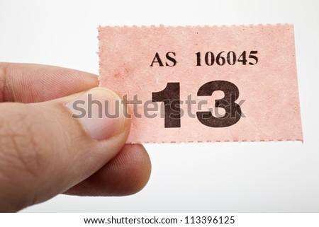 Holding a raffle ticket. - stock photo